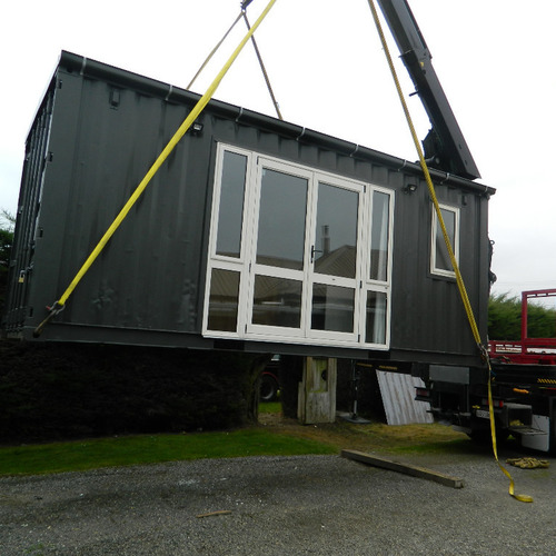 Workers accommodation container house getting lifted into place