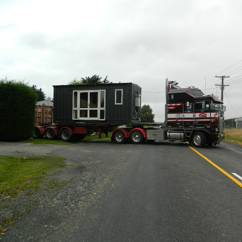 Workers shipping container accommodation on the move